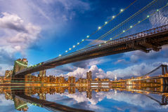 Wonderful panoramic sunset with Brooklyn and Manhattan Bridge re Royalty Free Stock Image