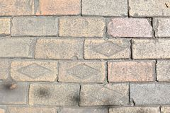 Dirty Brick Street Texture with Stamped Bricks royalty free stock photography