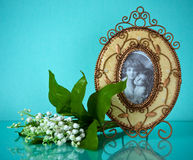 Wonderful picture frame and spring flowers on blue Royalty Free Stock Photography