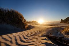 A wonderful place to visit in New Zealand. An amazing beach accessed through walk bushes and sand dune. The sand has repeating royalty free illustration