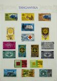 Wonderful Postage Stamps. View of a page of postage stamps from Tanganyika on a sheet of paper stock photography