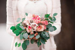 Wonderful pretty bride with wedding bouquet. Wedding flowers. Shallow depth of field. Wedding bouquet close-up. Wedding bouquet of Stock Photography