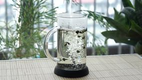 A wonderful process of flowering tea brewing in a glass teapot. A wonderful process of flowering tea brewing in a glass teapot stock video footage