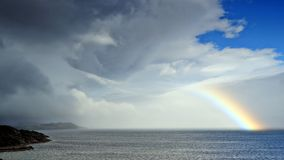 Wonderful rainbow over the sea Royalty Free Stock Photo