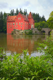 Wonderful red castle on the lake Stock Photo