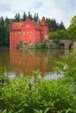 Wonderful red castle on the lake. (State Castle Cervena Lhota, Czech Republic, Eastern Europe Stock Photo