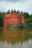 Wonderful red castle on the lake (vertically). Wonderful red castle on the lake (State Castle Cervena Lhota, Czech Republic, Eastern Europe Royalty Free Stock Photography
