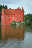 Wonderful red castle on the lake (vertically). Wonderful red castle on the lake (State Castle Cervena Lhota, Czech Republic, Eastern Europe Royalty Free Stock Images
