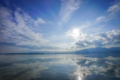 Wonderful reflexion mirror between sky, cloud, sunshine and sea, representative like paradise or heaven on eath., Thailand. Wonderful reflexion mirror between stock photography