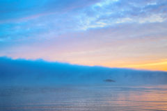 Wonderful river with large cloud of blue mist. At dawn for background Stock Photos