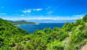 Wonderful romantic summer afternoon landscape panorama coastline Adriatic sea. The magical clear transparent azure water in the ba Stock Photos