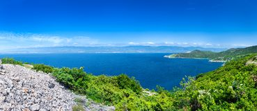 Wonderful romantic summer afternoon landscape panorama coastline Adriatic sea. The magical clear transparent azure water in the ba Royalty Free Stock Images