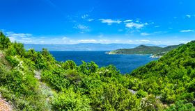 Wonderful romantic summer afternoon landscape panorama coastline Adriatic sea. The magical clear transparent azure water in the ba Stock Photography