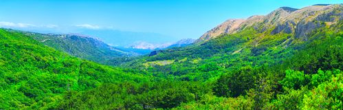 Wonderful romantic summer afternoon landscape panorama. Green, emerald valley of in the canyon plateau. Deciduous forest. Baska on royalty free stock photos