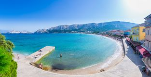Wonderful romantic summer afternoon seascape Adriatic island. Big, long, clean - pebbly Vela Plaža Beach in harbor at cristal cle. Ar blue water. Unrecognizable Stock Photography