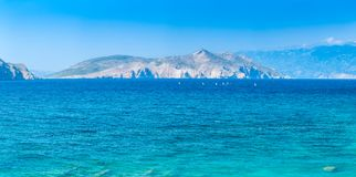Wonderful romantic summer afternoon seascape Adriatic island. Yachts in harbor at cristal clear turquoise water. Baska on the isla Stock Image