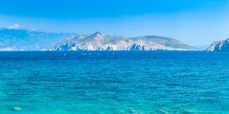 Wonderful romantic summer afternoon seascape Adriatic island. Yachts in harbor at cristal clear turquoise water. Baska on the isla stock images