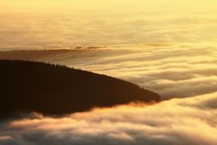 Wonderful scenery, above the clouds at beautiful day in autumn, Europe. Landscape with alpine mountain valley, low clouds, forest. Beauty of nature concept royalty free stock image