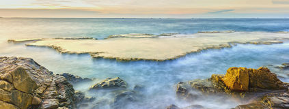 Wonderful seascape with sea waves hitting large rock. Formed soft sheet like a cascade of water floating in the morning to greet the new day Stock Images