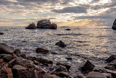 Wonderful seascape at sunset. Seascape at sunset on the rocky coast of the Black Sea in Crimea Stock Photography