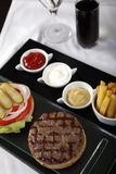 Wonderful service for Burger menu. With cola and sauces Royalty Free Stock Image