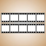 A wonderful simple design of a blue photographic film. On a brown background Stock Images