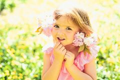 Wonderful smell. Small child. Natural beauty. Childrens day. Springtime. weather forecast. Little girl in sunny spring royalty free stock photo