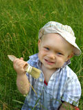 Wonderful smiling child with a brush for painting  Stock Photo