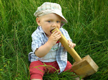 Wonderful smiling child with a wooden hammer Stock Image