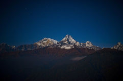 Wonderful snow mountain with the star. Snowing night scenes and sunrise Stock Image