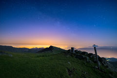 The wonderful starry sky over Torino Turin, Italy from the majestic mountain range of the Italian Alps, with glowing lights of t Stock Photography