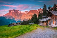 Free Wonderful Summer Alpine Location With Wooden Huts And Mountains, Switzerland Royalty Free Stock Photos - 166151468