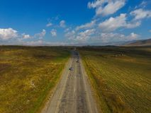 Wonderful summer landscape with a road and green fields, Armenia. A wonderful summer landscape with a road and green fields, Armenia royalty free stock photography