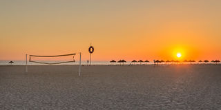 Wonderful summer sunset at the beach volleyball court. Royalty Free Stock Photography