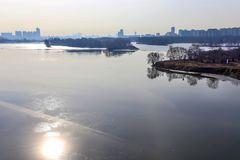 A wonderful sunny day of the beginning of April.  Ice on Moscow River. Some people catst  fish on ice dangerous. outskirts of Moscow stock photography