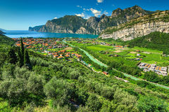 Wonderful sunny day on Lake Garda, Torbole, Italy, Europe. Stunning landscape with Lake Garda and Sarca river near Torbole town, Northern Italy, Europe Royalty Free Stock Images