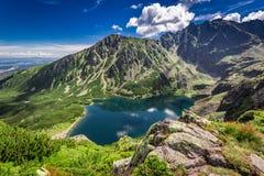 Wonderful sunrise at Czarny Staw Gasienicowy in summer, Tatras. Europe Royalty Free Stock Images
