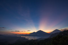 Wonderful sunrise near the volcano and lake Batur. Bali, Indonesia Stock Image