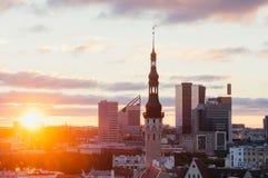Wonderful sunrise over townhall and modern buildings, Tallinn Stock Image