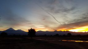Wonderful sunrise on the volcanoes of the Andean cordillera, Atacama Desert, Chile. Sunrise lights in the arid and desolate landscape of the Atacama Desert and stock photo