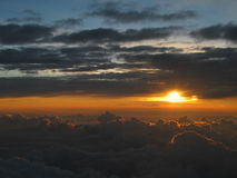 Wonderful sunset above the clouds, peaceful meditative atmosphere Royalty Free Stock Images