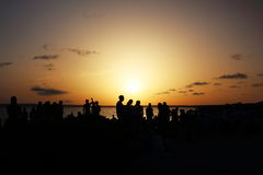 Wonderful sunset celebrated by many people at Pirata Bus Bar in Formentera, BalearicIslands, Spain Royalty Free Stock Photo
