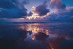 Reflection of a sunset at the danish coast stock photography