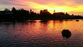 Wonderful sunset over the river. Sunset over the Thajeen river at Don Wai floating market, Nakhon Pathom province Stock Images