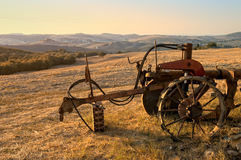 Wonderful sunset in the Tuscan countryside. Picture of wonderful sunset in the Tuscan countryside, with a plow in the foreground Royalty Free Stock Images