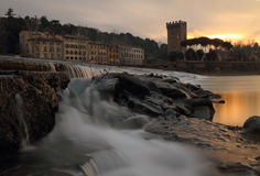Wonderful sunset at waterfallas on river Arno in Florence Stock Photography