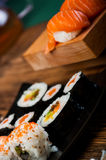 Wonderful sushi set, oriental theme on the old wooden table Stock Image