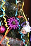 Wonderful toys and tinsel on the Christmas tree royalty free stock images