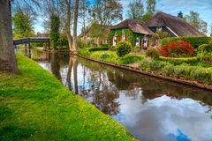 Amazing dutch village and traditional houses, Giethoorn, Netherlands, Europe royalty free stock photo