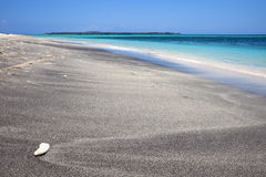 Wonderful tropical beach. Single stone on a beach with turquoise water Royalty Free Stock Images